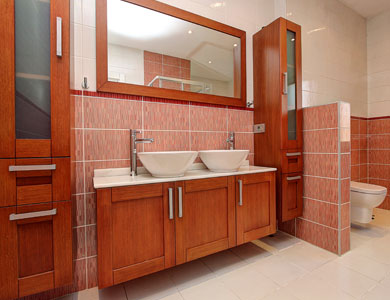 Dual sink bathroom with wood cabinets