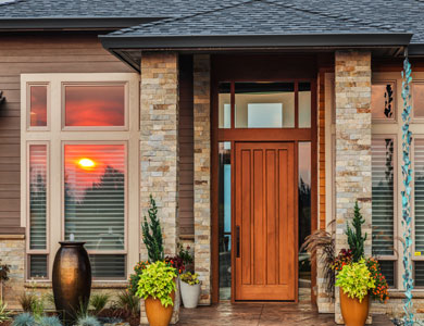 Home entrance with wood and brick accents.