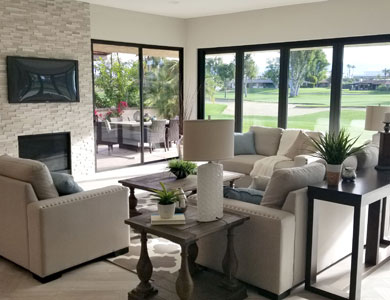 Living Room seating area with fireplace and views to backyard.