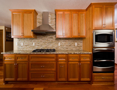 Kitchen cabinets, backsplash and stove