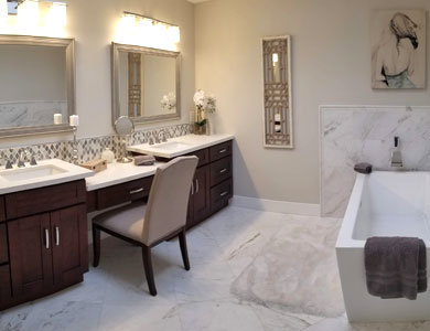 Bathroom with dual sink vanity and rectangular tub.