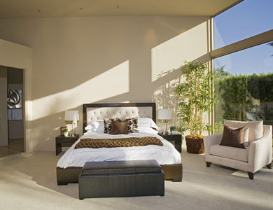 Bedroom with one wall of glass.